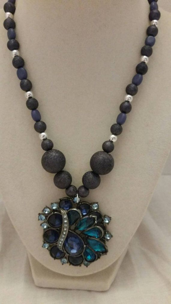 Check out this item in my Etsy shop https://www.etsy.com/listing/241216966/blue-jeweled-necklace-statement-necklace