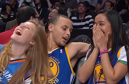 Stephen Curry, at the bench, with 2