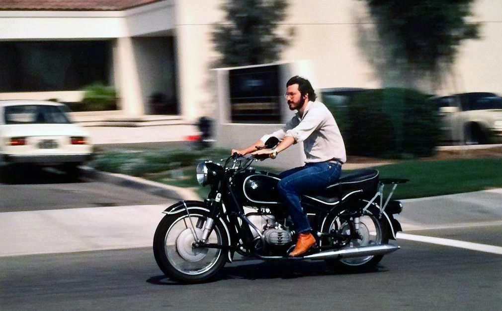 Steve Jobs 27 years old riding his 1966 BMW R60/2 motorcycle in Cupertino California in 1982.