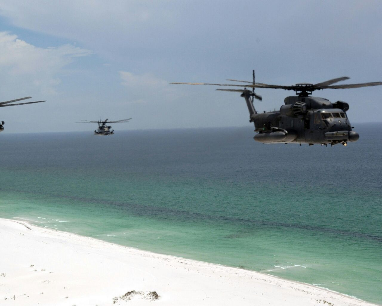 Helicopters flying along the emerald coast, Florida