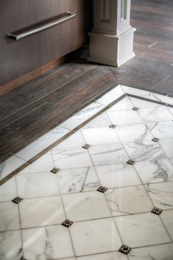 Calacatta Gold Marble Floor Tile With Decorative Inserts Create An Elegant Floor Medallion In This Kitchen Pho Stone Flooring Decorative Floor Tile Tile Floor