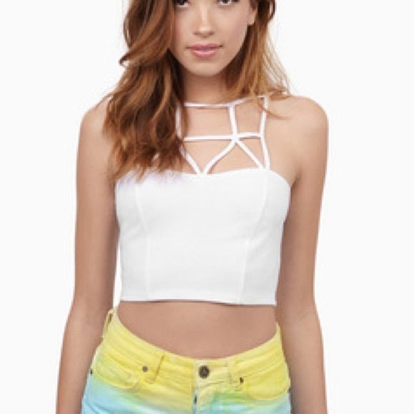 NWT Tobi caged in crop top BRAND NEW! This is sold out on the website! Perfect for music festivals, going out, or wearing casual under a sweater Tobi Tops Crop Tops