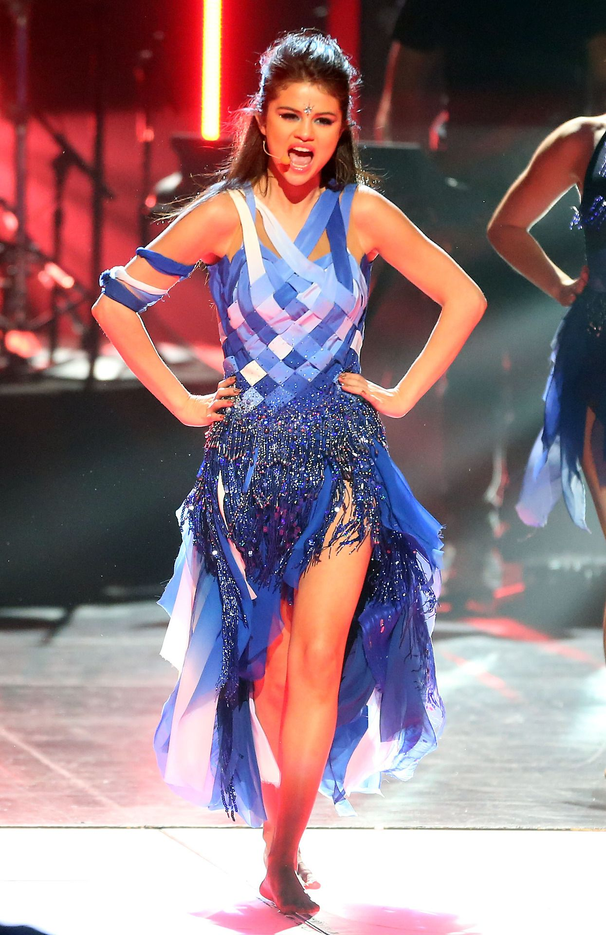Selena Gomez wears a fun, blue, tribal dress performing ...