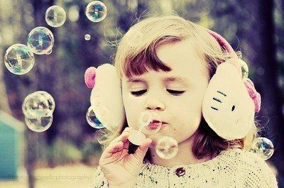 Cute girl playing with bubbles