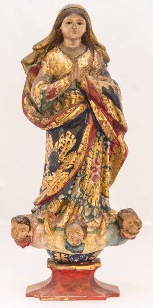 Imagem de Nossa Senhora da Conceição, madeira policromada. Bahia, século XIX. Alt. 28cm. Vendida 700,00.