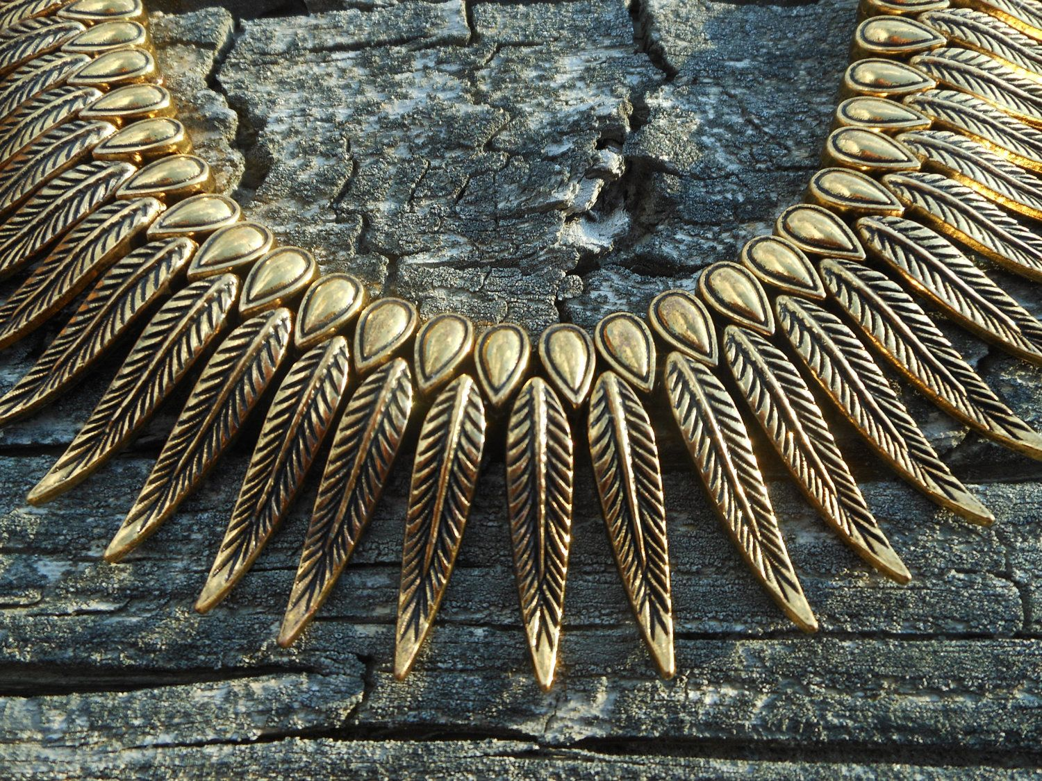 Gold feather Hmong Miao brass tribal necklace. $75.00, via Etsy.
