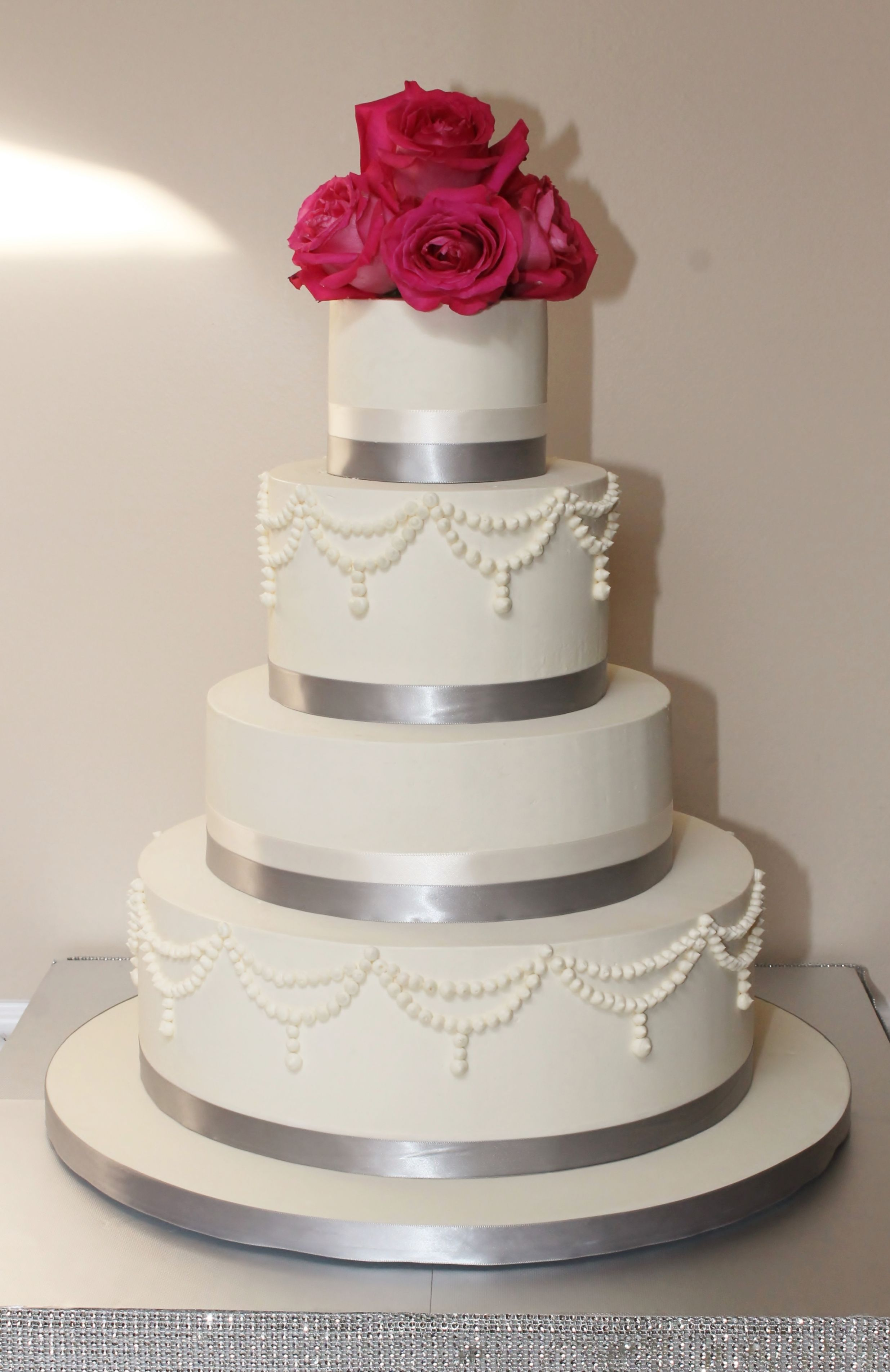 Four Tier Buttercream Finished Wedding Cake With Piped Pearls Swags