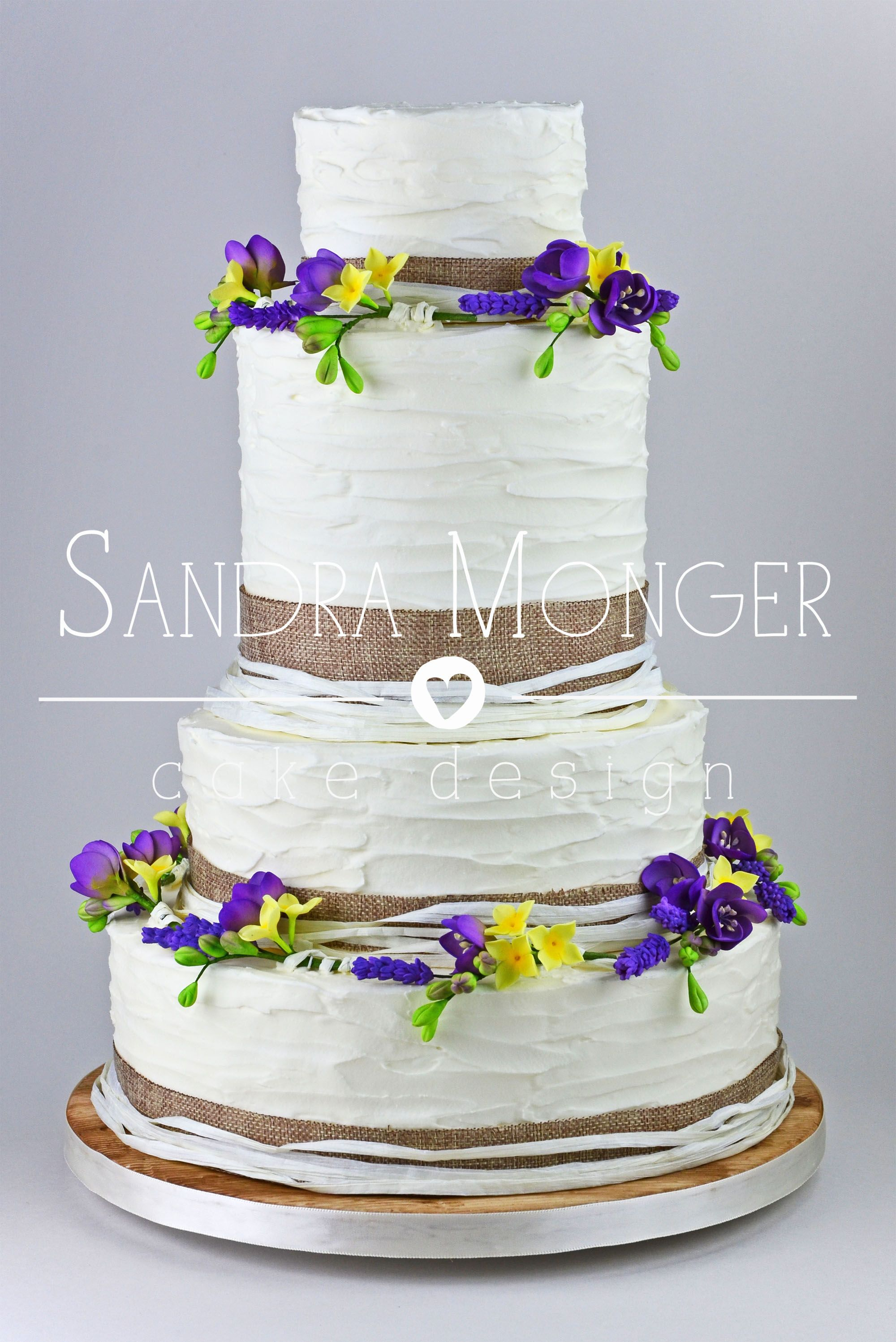 Rustic style wedding cake with natural hessian and raffia and sugar ...