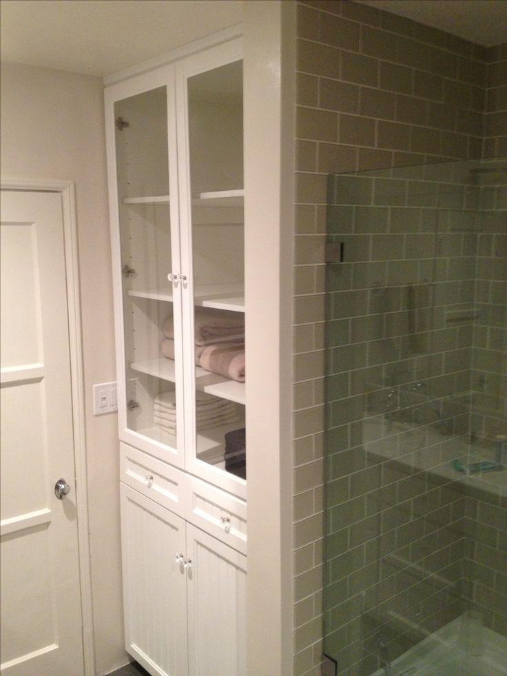 White Bathroom Linen Closet With Hamper Plenty Of Shelves For