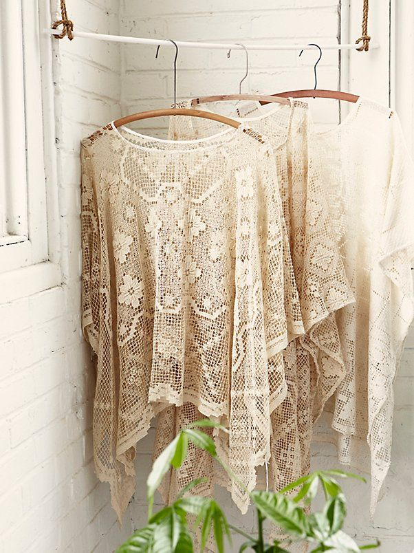 FP Vintage Revival Geo Lace Poncho | Hand-sewn from vintage tablecloths dating back to the 1920s, these one-of-a-kind vintage lace ponchos have been reworked in Philadelphia. Their timeless bohemian shape and effortless appeal make them our most sought after layer for an unforgettable summer. Squared hem.
