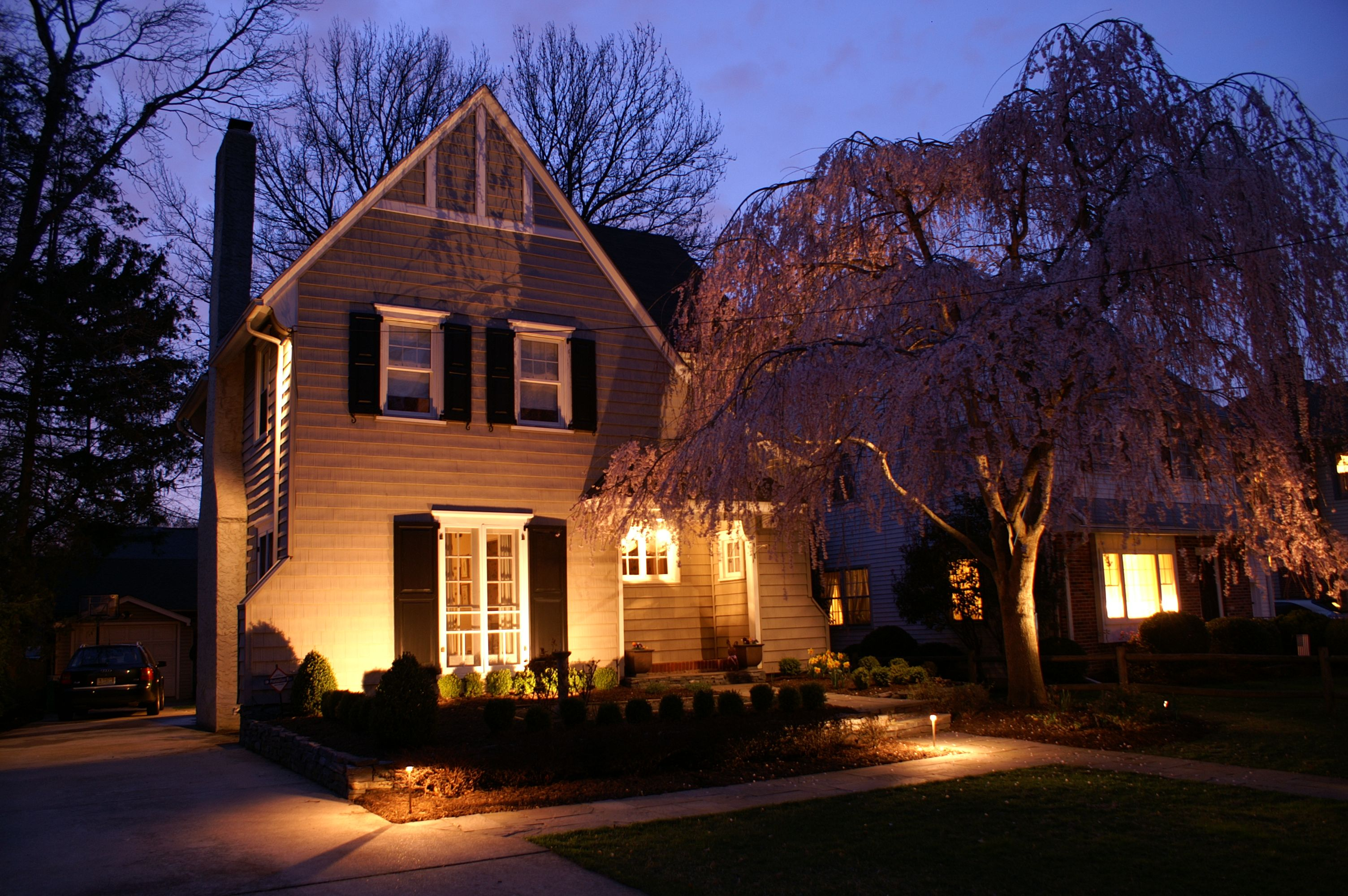 Classic Tudor Style Home Featuring Pathlights Uplighting On The