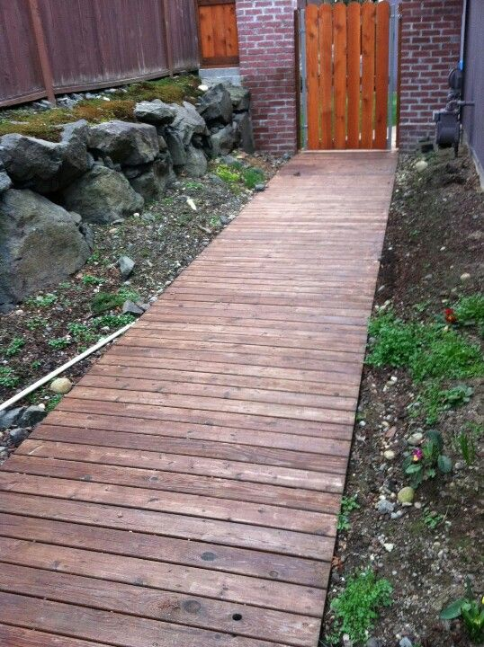 Blooming wood boardwalk with window wall slab pathway for Wooden walkway plans