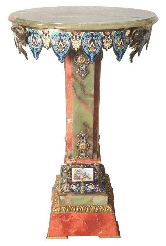 A 19TH CENTURY ORMOLU MOUNTED ONYX TABLE WITH SEVRES : Lot 0271