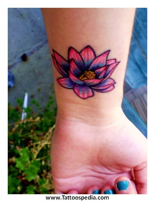 9f0518e6b43e7 dark colored flower tattoos | Lotus Flower Tattoo Lower Back 2 » Lotus  Flower Tattoo Meaning Color .