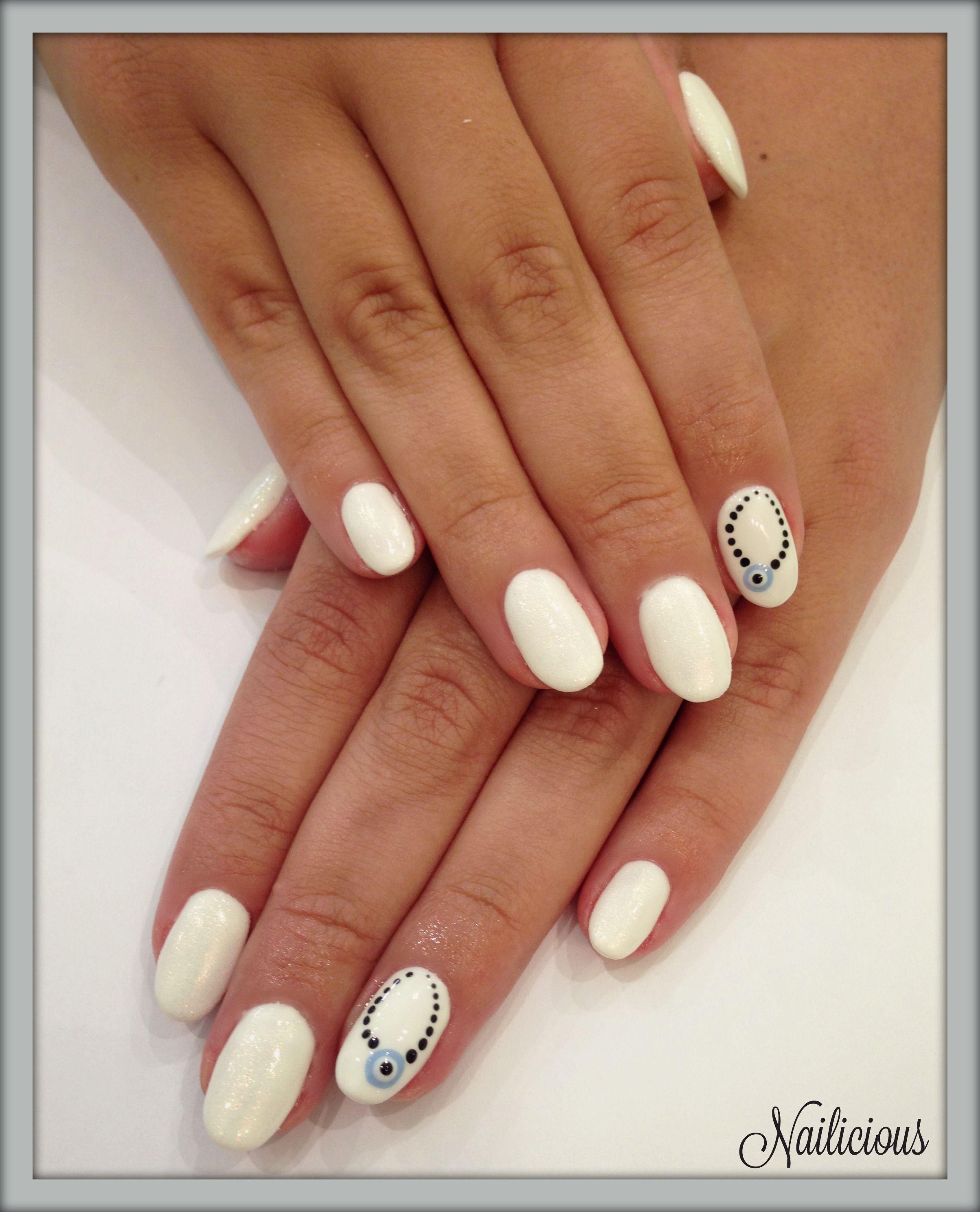 White nails with evil eye nail art | NAILICIOUS My Beauty Salon ...