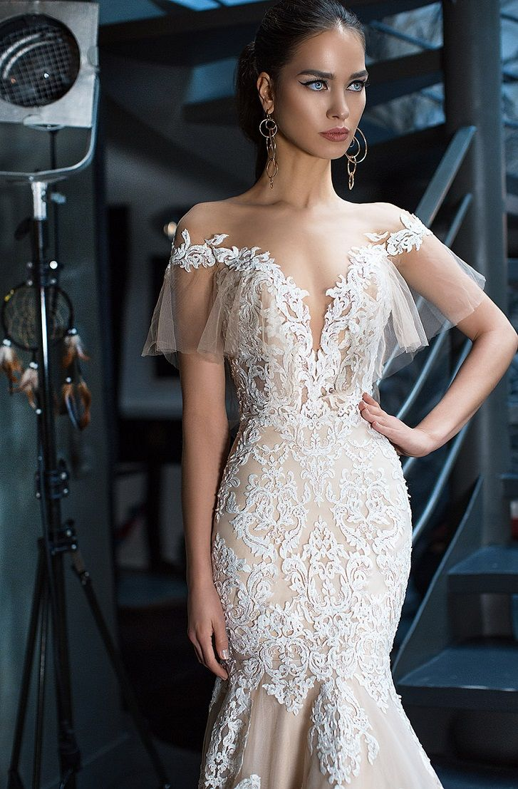Off the shoulder deep v-neckline with tender flounce sleeves and luxurious lace on light tulle with nude lining mermaid wedding dress #wedding #weddings #weddingdress #mermaidgown