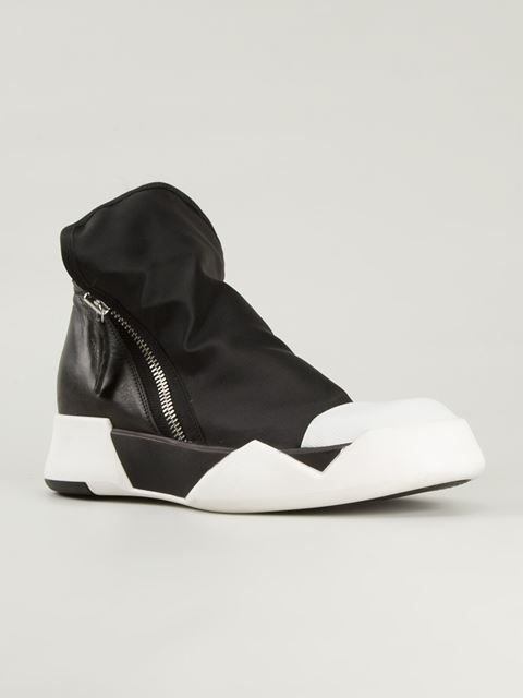 f1377fa6451 Balmain, Saint Laurent, Prada & Burberry are just some of the great  designers to feature in our men's collection of designer hi-tops at Farfetch .