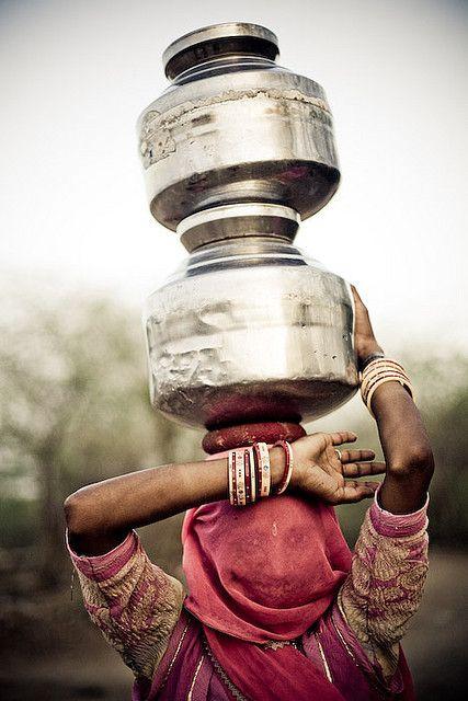 Woman carrying water by Swiatoslaw Wojtkowiak...