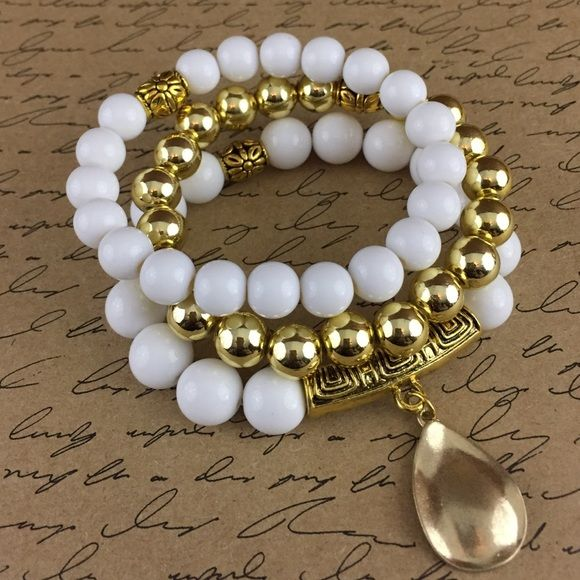 Bracelet Set Gold, white acrylic stretch bracelets with gold tone metals and metal accent dangling charm. D.Green Designs Jewelry Bracelets