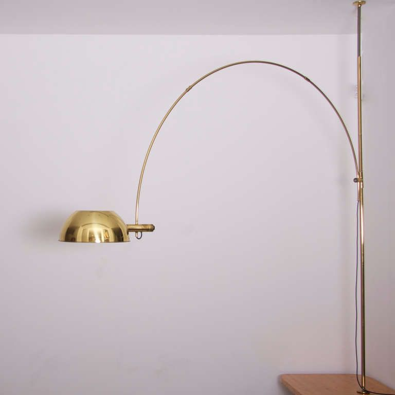 Florian schulz bow lamp in brass