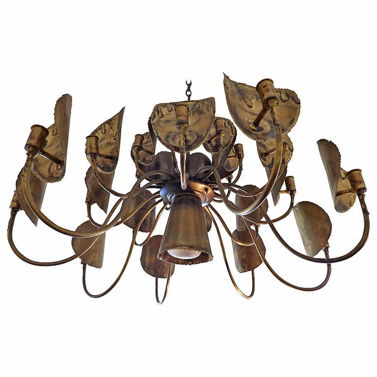 Large Brutalist Chandelier by Tom Greene for Feldman Company   From a unique collection of antique and modern chandeliers and pendants  at https://www.1stdibs.com/furniture/lighting/chandeliers-pendant-lights/
