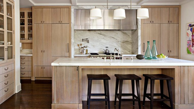 A mix of materials in a modern cottage look light wood with a good