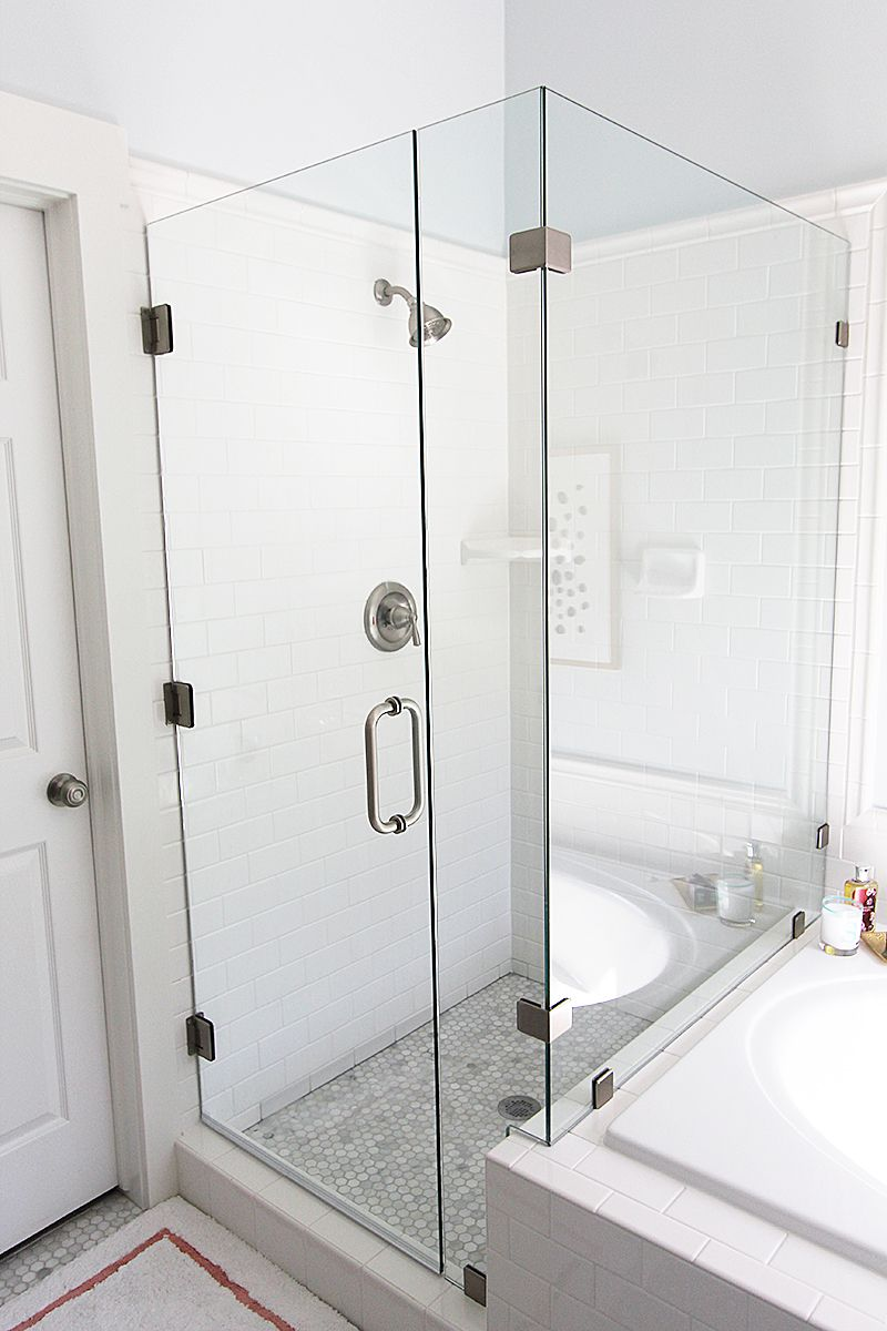 frameless glass shower next to tiled tub. like the border around the ...