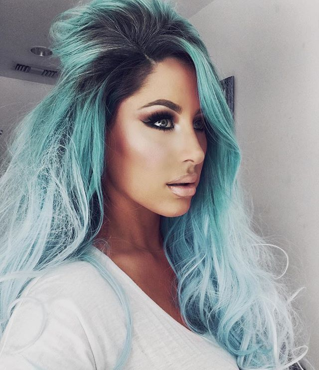 love this black to teal to baby blue colors, and her make up is flawless!