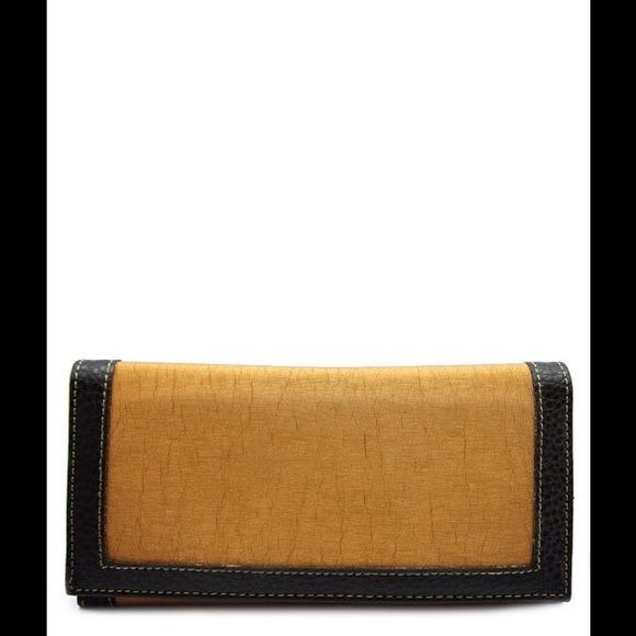 Wallet in Rich Gold and Black. This wallet is sharp!   3 part button closure.    Bill fold, credit card holder, ID window.   Gold with black trim.   Elegant vegan leather.   Is wallet looks very expensive. Bags Wallets