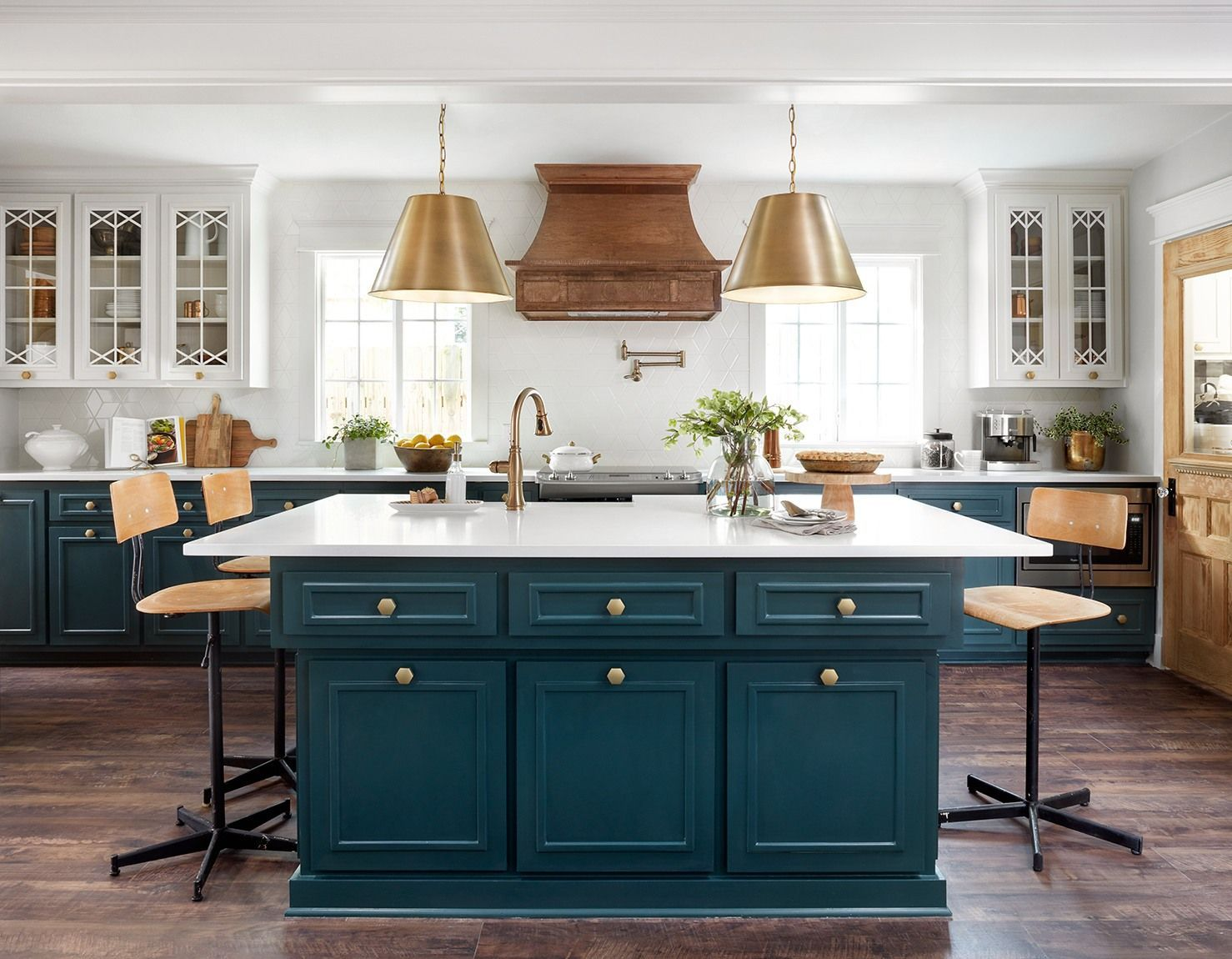 The brass pendant lighting adds a modern element to the kitchen and