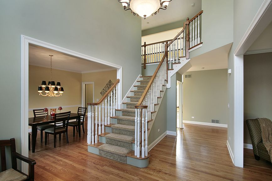 2 Story Foyer With Hard Wood Floor And Open Entrance Into The Formal Dining Room
