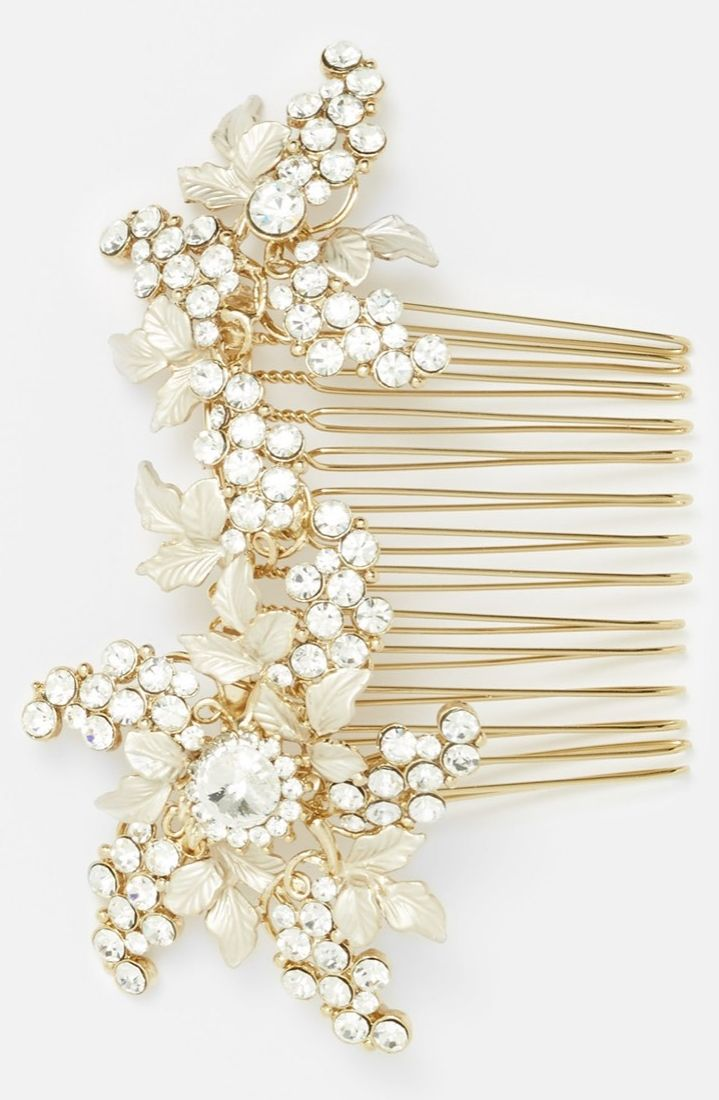 Love how delicate sprays of crystal flowers and tiny golden leaves adorn this stunning wedding hair comb.