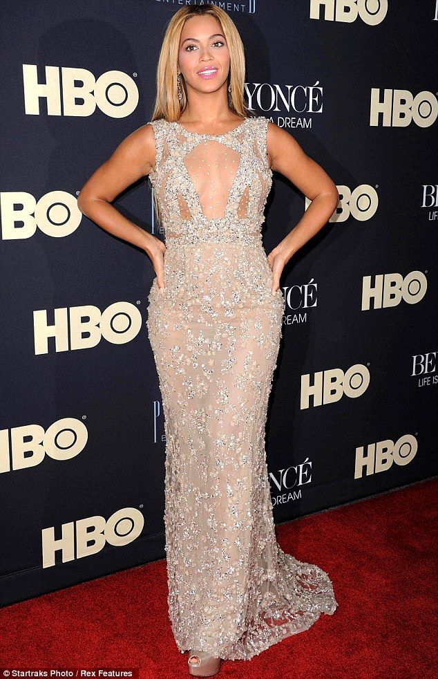 Sheer daring: Beyonce displayed plenty of her decolletage in a  daring sheer floor length Elie Saab gown as she stepped onto the   red-carpet for the premiere of her documentary Life Is But a Dream.
