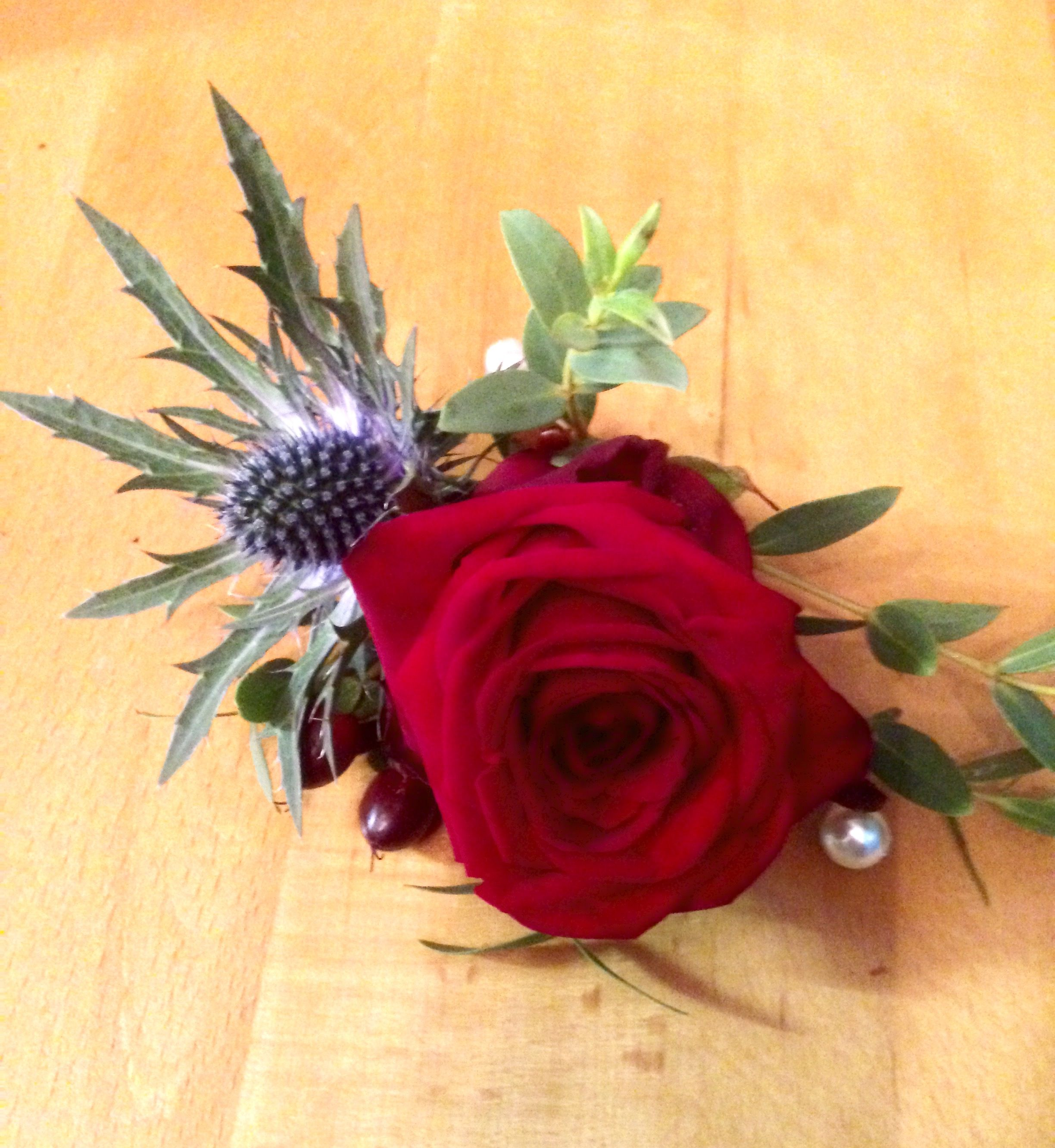 Red naomi rose buttonhole with thistle, hypericum berries and ...