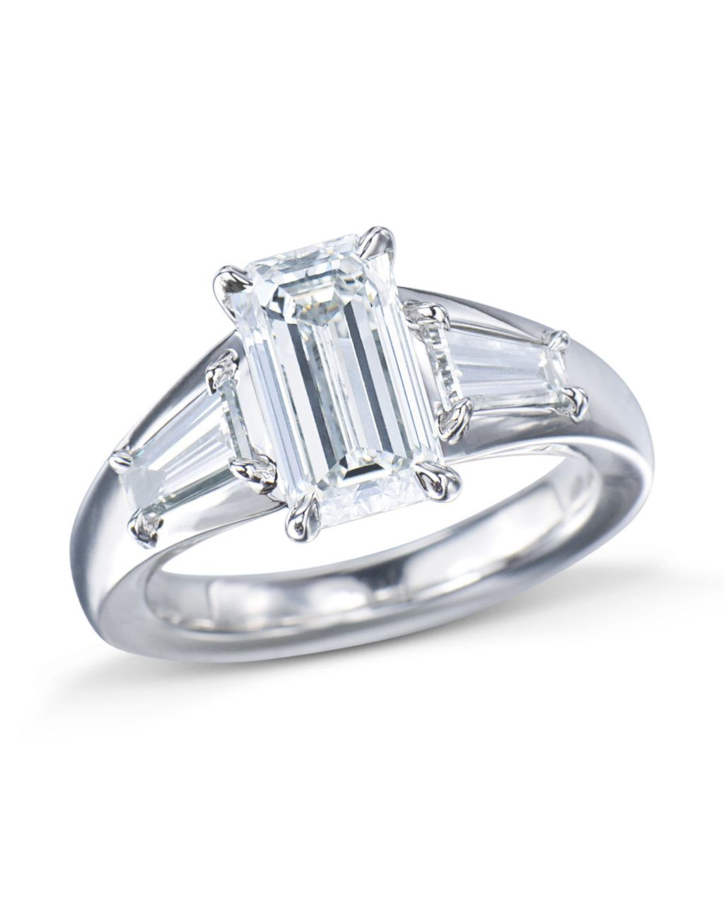 33bb5ad28 A modern emerald cut diamond engagement ring with a unique design  twist.Expertly made in precious platinum with a bold tapered band that  embraces a stunning ...