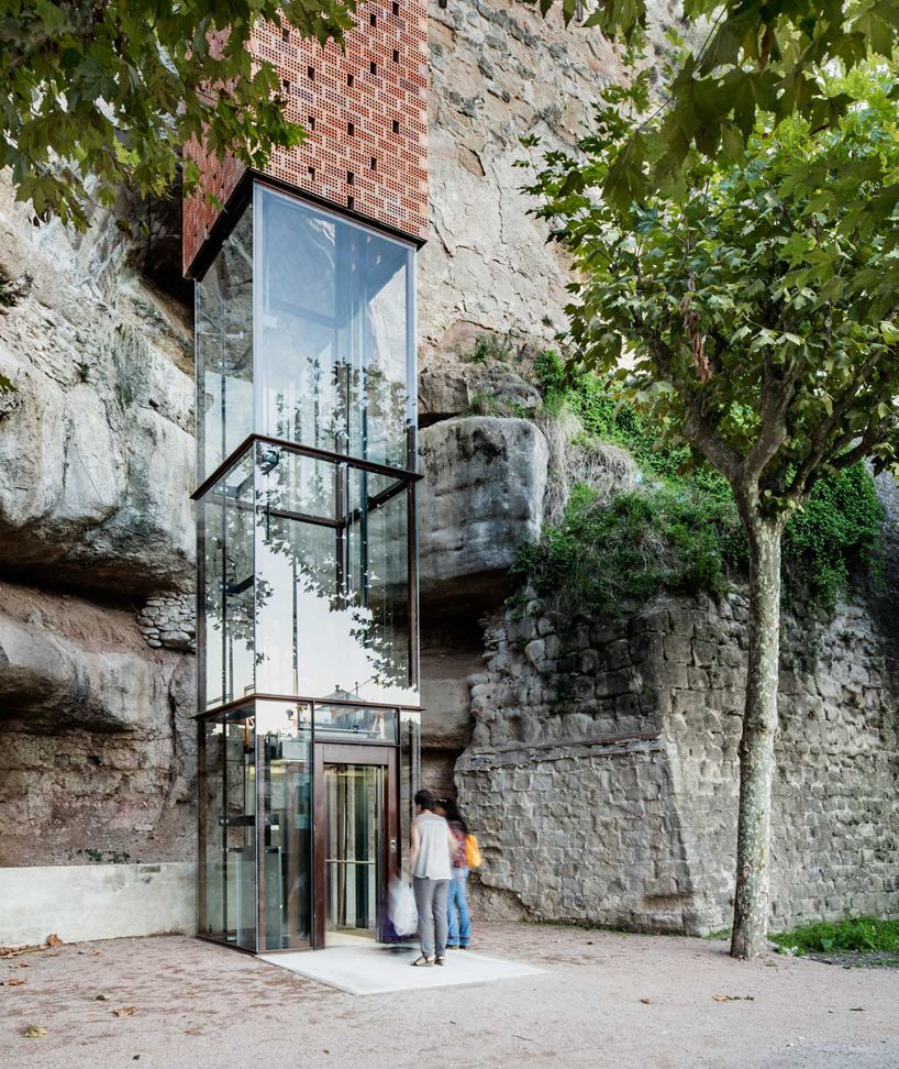 33 Staircase Designs Enriching Modern Interiors With: Carles Enrich Wraps Elevator In Catalonia With A Brick