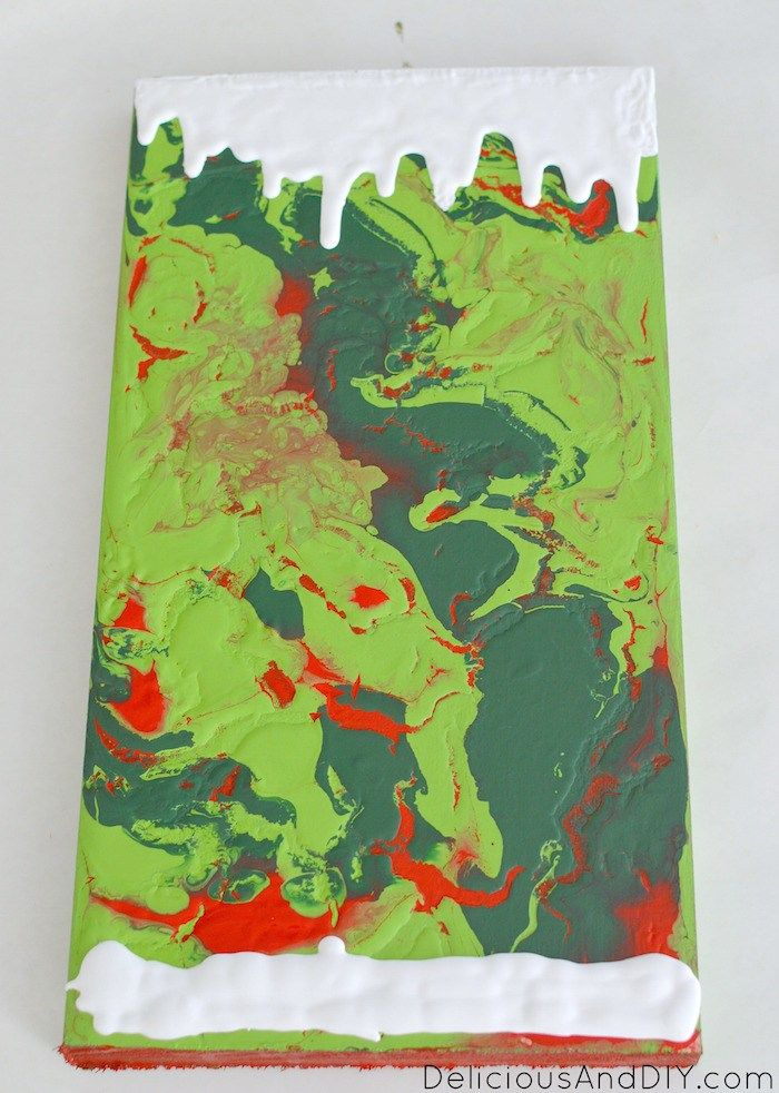 DIY Christmas Wood Sign is part of Christmas diy wood, Christmas signs wood, Wood wall art decor, Painting crafts, Christmas wooden signs, Christmas wood - Learn how you can make this beautiful Marbled Christmas Wood Sign in a few simple steps just by using paints, stencils and some glitter