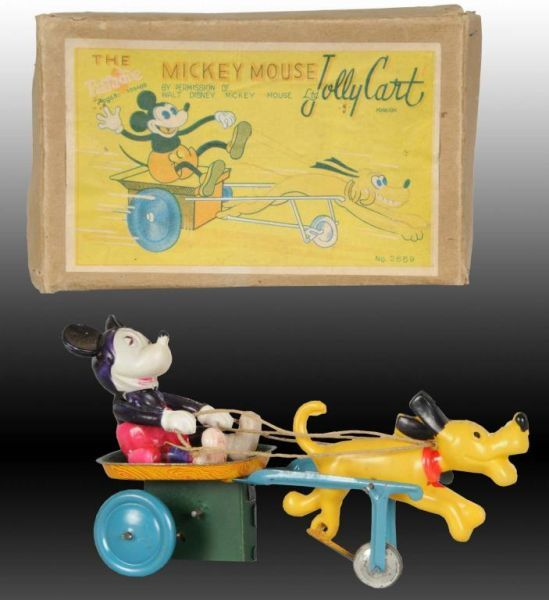 Lot # : 1441 - Walt Disney Celluloid Mickey Mouse Jolly Cart Toy.