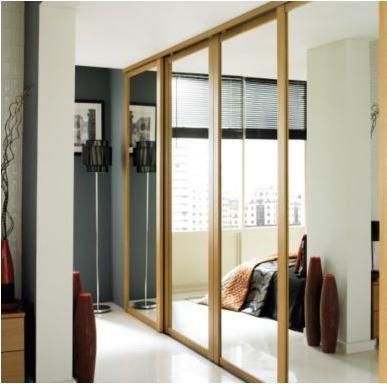 Mirrored sliding wardrobe door windsor oak style b q for B q bedrooms sliding wardrobe doors