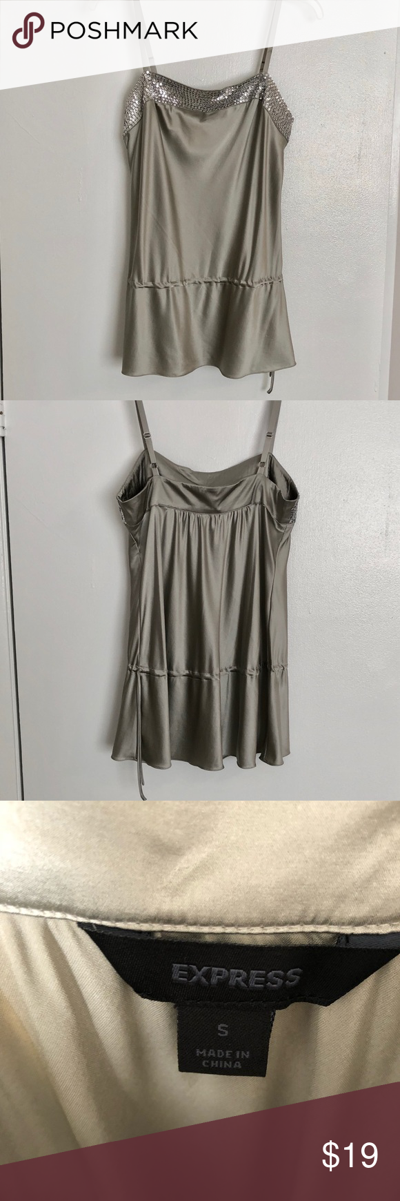 Gorgeous Silk Express Tank This beautiful tank is silky soft and flows beautifully.  Sequins add a touch of sophisticated flashiness.  Excellent condition, worn once and hand washed.  Ready to be worn at your next event! Express Tops Camisoles