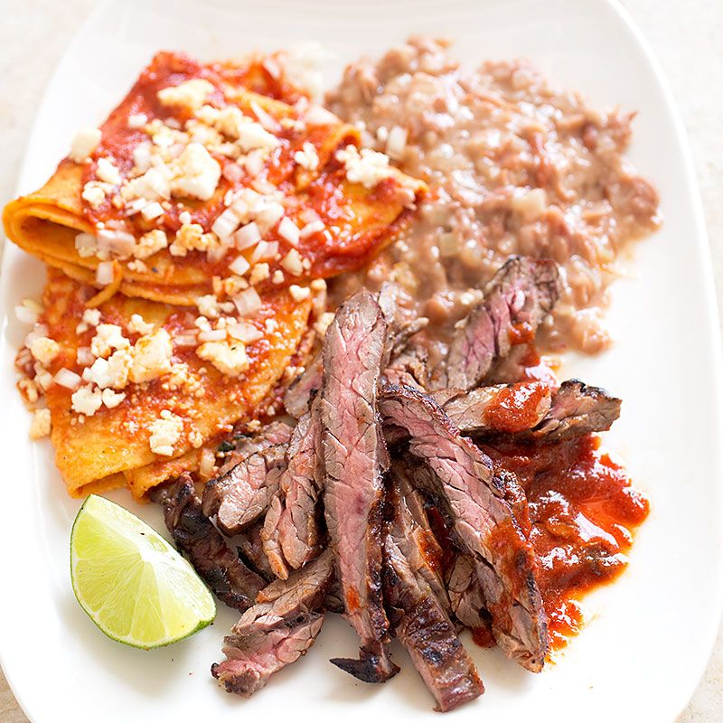 These simple enchiladas were developed to be served as part of a larger meal with carne asada, beans, and salad, but they can be eaten anytime.