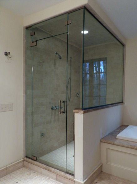 Frameless glass bathtub doors with glass half wall for Half wall shower glass