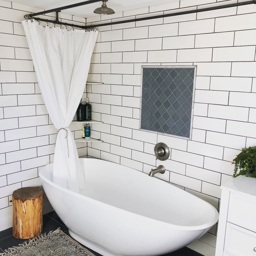 Large soaker tub with rain head shower. White subway tile slate ...