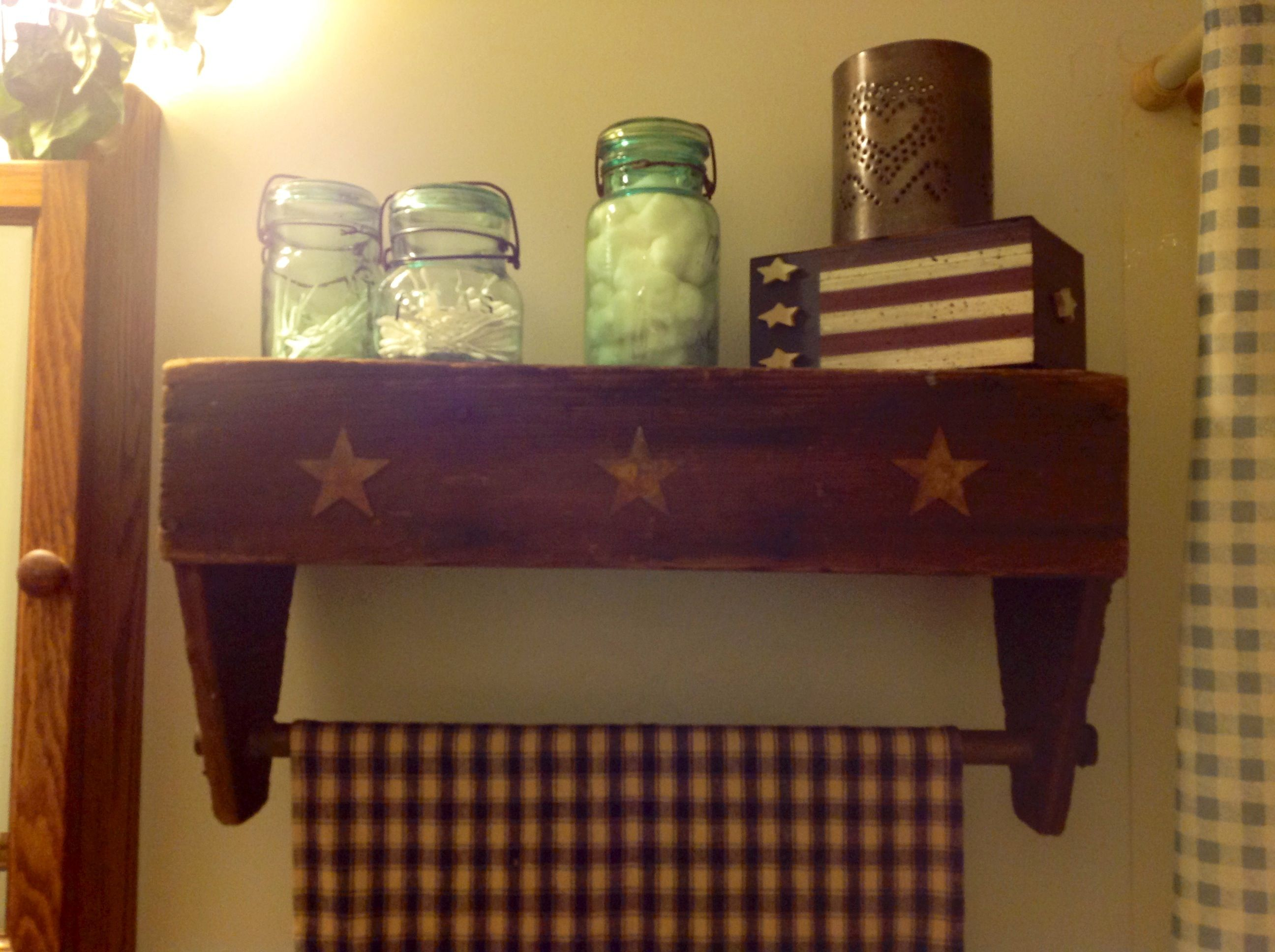 An Old Wooden Tool Box Flipped Upside Down And Used As Shelf W
