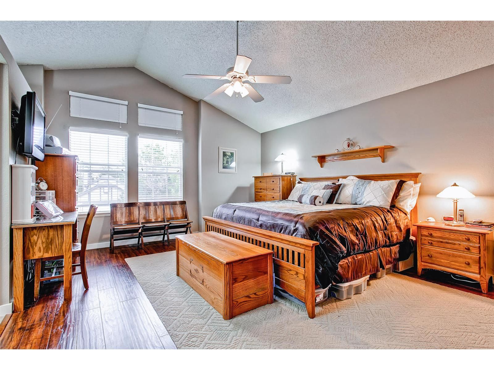 Large master bedroom with vaulted ceilings, natural light