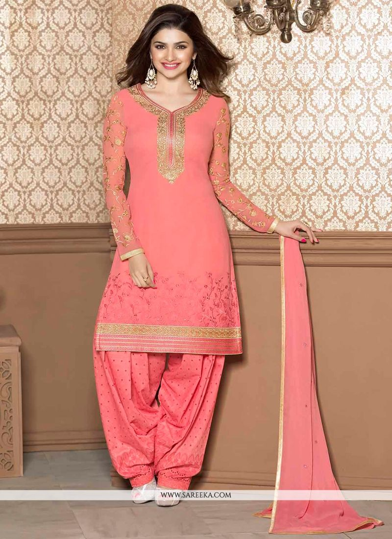 Prachi desai pink georgette punjabi suit lining designed with embroidery, resham, lace and patch border work.