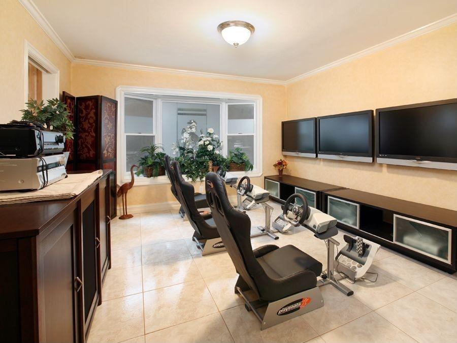 Modern Game Room With Travertine Floors, Flush Light, Bay Window, Crown  Molding