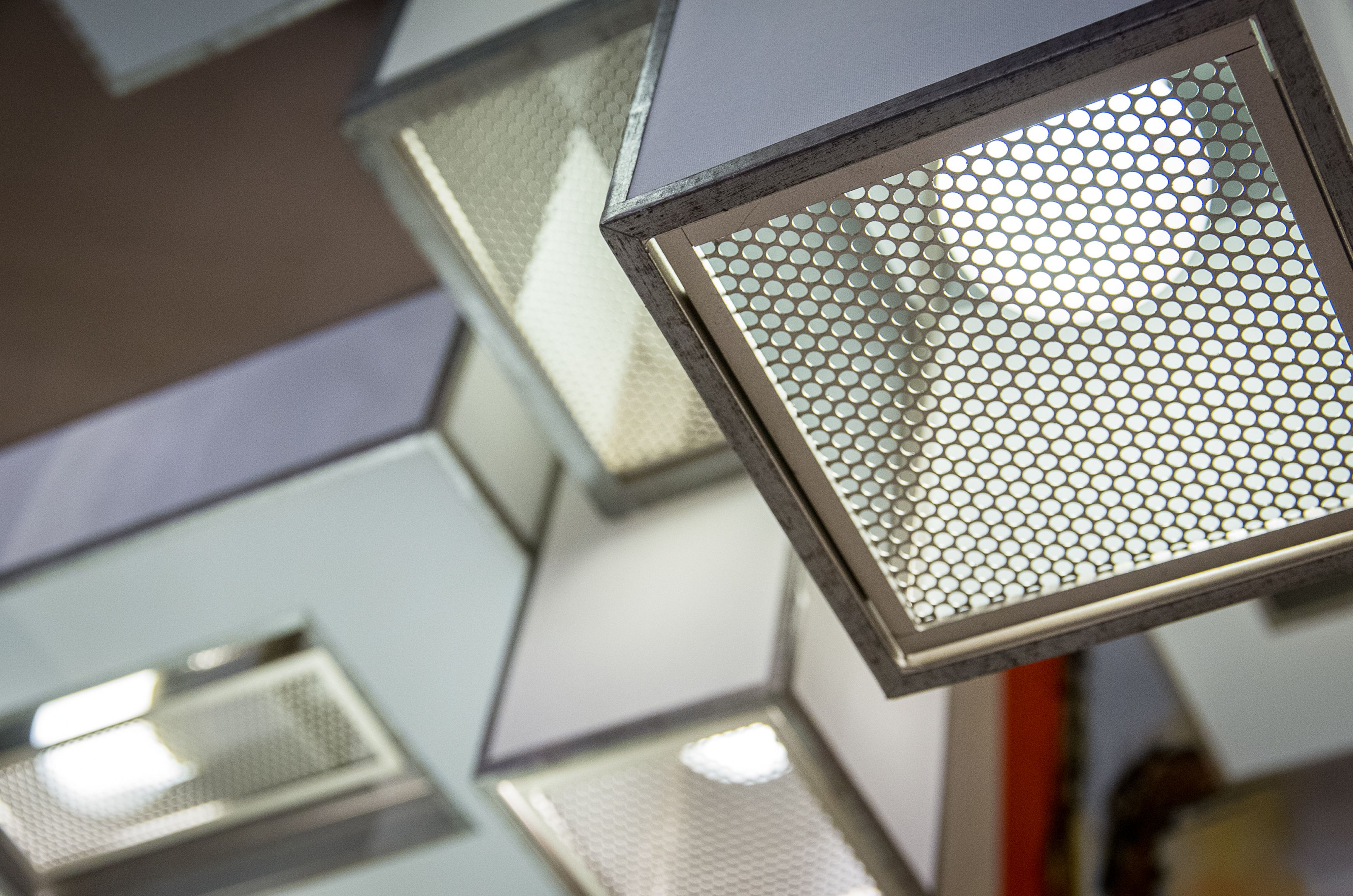 Close up of Fine Art Perspectives in silver and white. Metal mesh ...