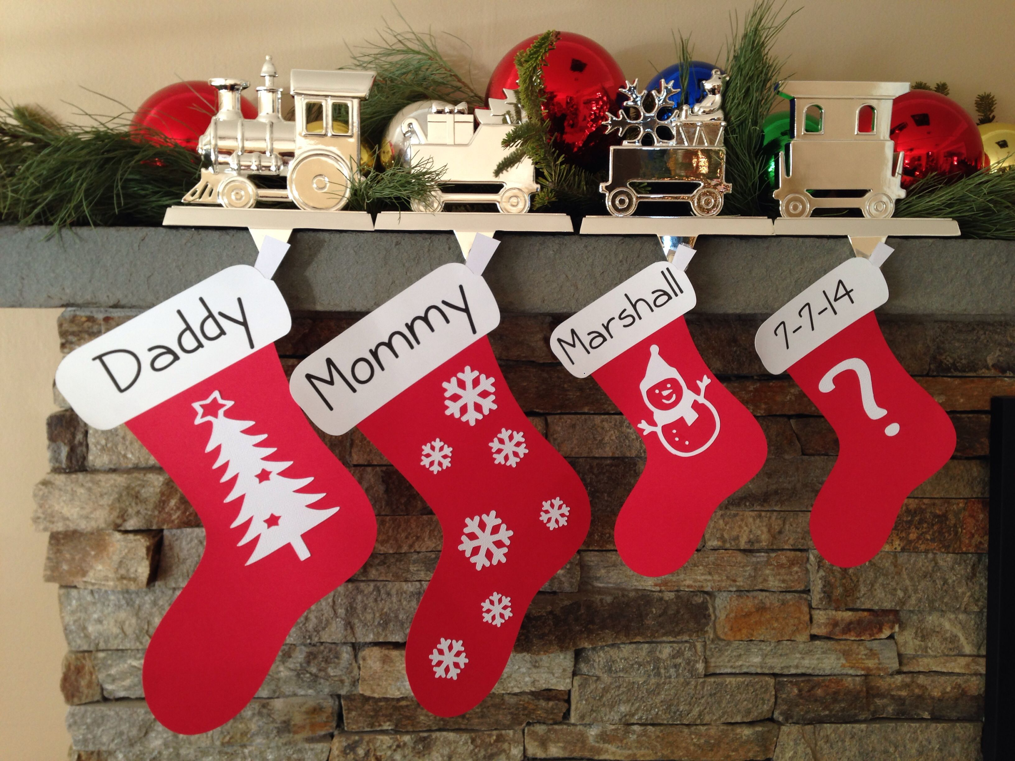"""Christmas time pregnancy announcement with card stock """"stockings"""