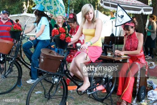 Stock Photo : Woman operating pedal powered sewing machine at Womadelaide festival.